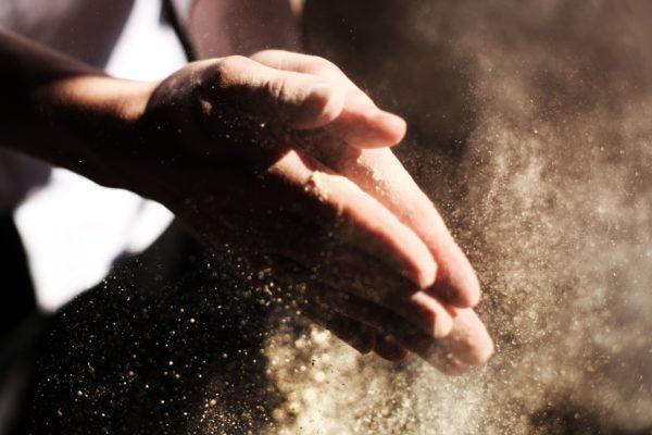 Hände und Sand